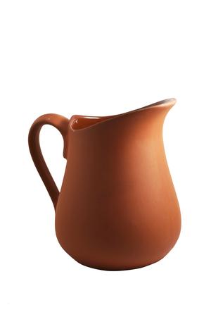 antique vase: traditional brown ceramic jug on white background