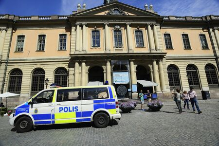 STOCKHOLM, SWEDEN  – JUNE 15, 2017: police car in the center of the old town near the Nobel Museum Editorial
