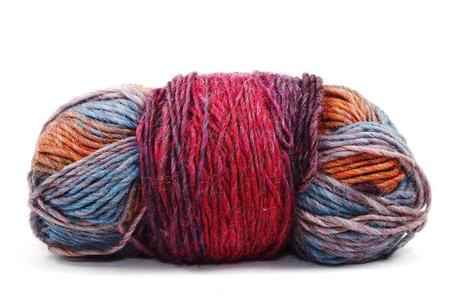 Ball of varicoloured wool on white background Stock Photo