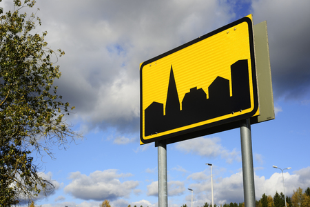 road sign locality on the sky background