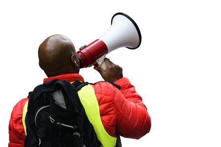 Activiste avec le mégaphone lors d'une manifestation, isolé