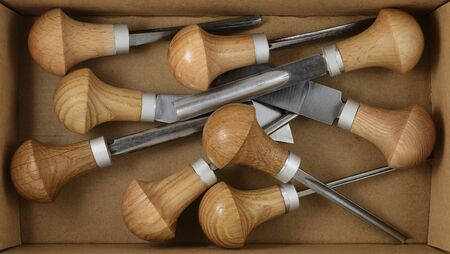 set of tools for carving in a cardboard box