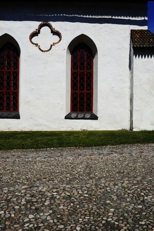 wall of a medieval church and cobblestone pavement in Porvoo, Finland