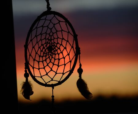 dream catcher on the background of a beautiful sunset
