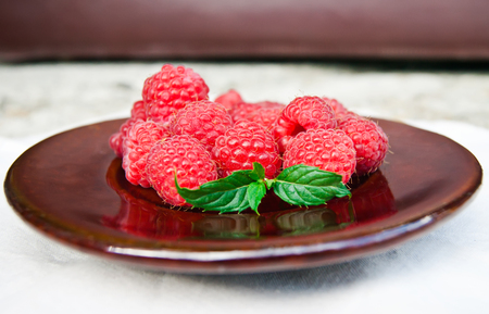 organic raspberry: Fresh organic raspberry in plate. Selective focus Stock Photo