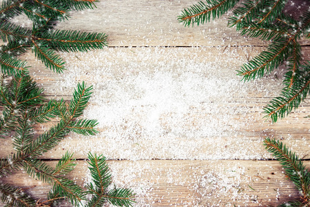 retro background: Christmas tree on wooden background