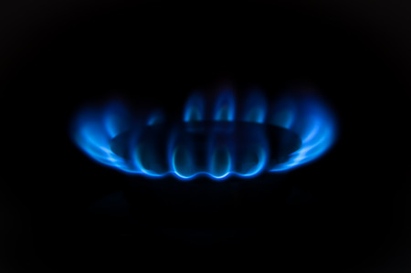 blue flames: Gas burners in the kitchen oven Stock Photo