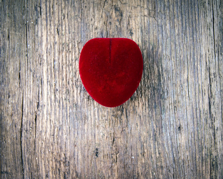red heart on a wooden background photo