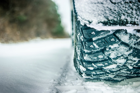 winter tires: Good winter tires on snowy road Stock Photo