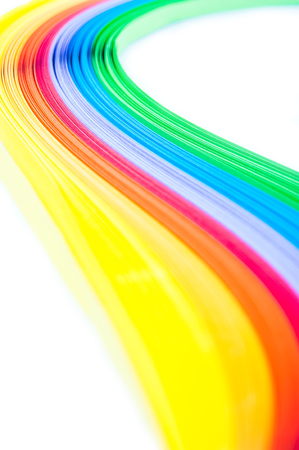 quilling: Rainbow colored quilling paper laid out in waves and shapes