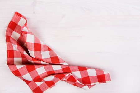 white red: Table kitchen napkin on wooden background