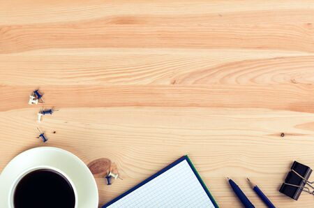 write background: notebook pen and cup of coffee in wood table