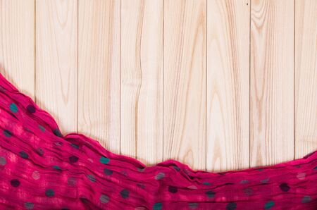 red scarf: red scarf on wooden background Stock Photo