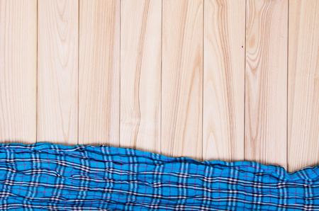 neckwear: blue checkered scarf on a wooden background