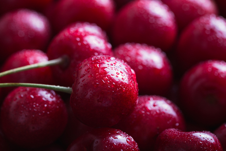 Close-up of wet cherries with water drops. Stock Photo