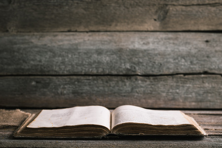 An old book on an old wooden background