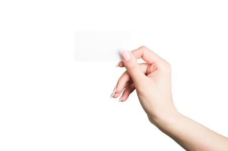 Main féminine tenant une carte de visite vierge Banque d'images