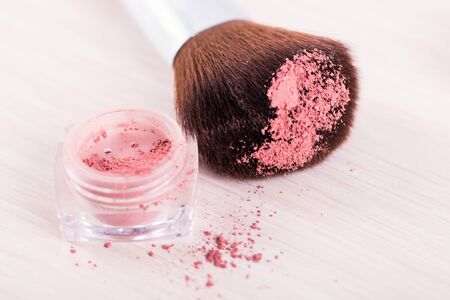 skintone: make up brush with red powder . cosmetics