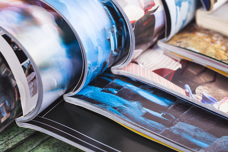stack: stack of open colorful magazines. information Stock Photo