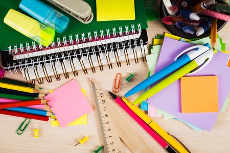 write background: School and office accessories on wooden background