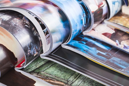 fashion magazine: stack of open colorful magazines Stock Photo