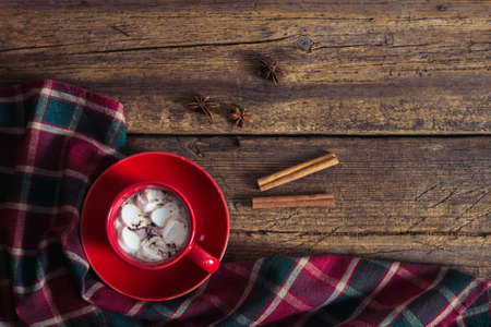 holiday food: red cup with cocoa and marshmallows on the wooden background Stock Photo