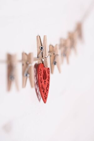 hitched: Cards and heart hanging on a rope hitched clothespins. Stock Photo