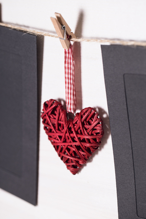 Cards and heart hanging on a rope hitched clothespins. Stock Photo
