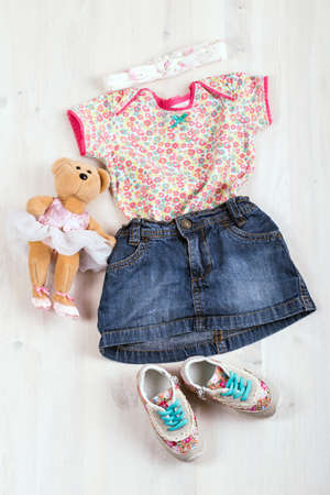 children clothing: set of childrens clothing and shoes on a wooden background Stock Photo