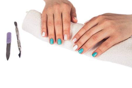 stamping: beautiful manicure. gel polish coating in white and turquoise, stamping.