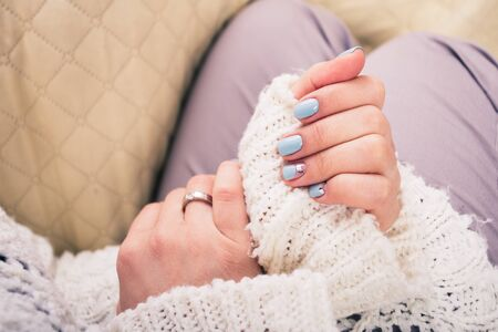 embossing: beautiful manicure. Gel polish coating in blue, embossing. Stock Photo