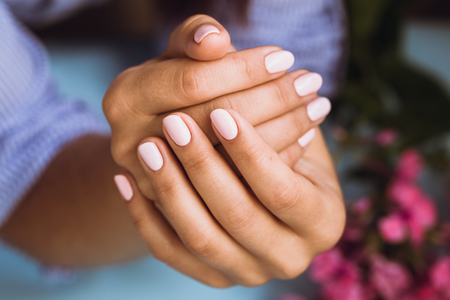 Beautiful womans nails with beautiful pink manicure
