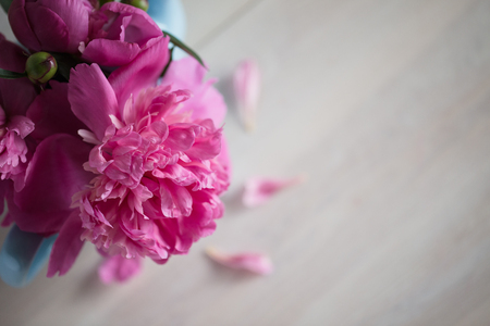 flori culture: pink peonies on wooden background