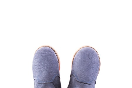 children s feet: Stylish winter childrens shoes on a white background Stock Photo