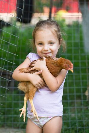 people series: little girl with red hen