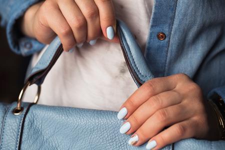 Beautiful manicure. Gel polish coating in blue, embossing.