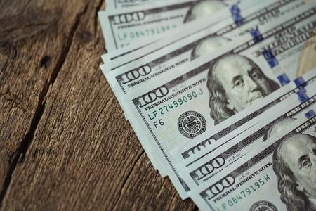 American dollar money bills spread on old wooden background Stock Photo
