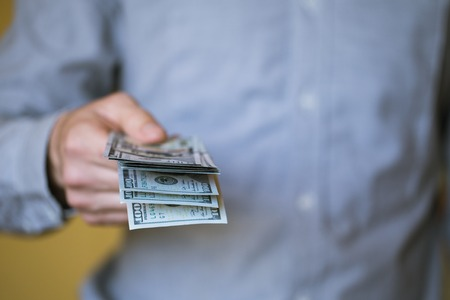 Businessman holding money in his hands Stock Photo