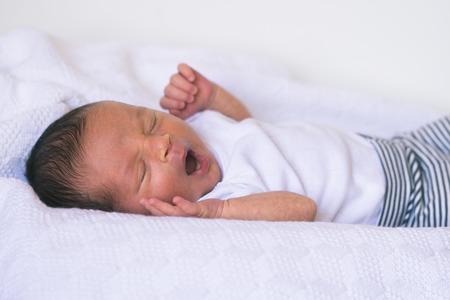 Newborn baby yawns, two week old