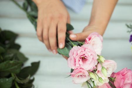Female florist making beautiful bouquet at flower shop Stock Photo