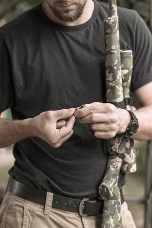 Hunter loading his gun