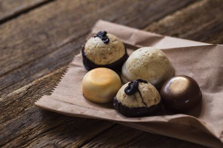 Chocolate pralines on old wooden table. Food Stock Photo - 87391950