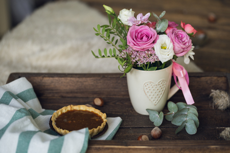 Beautiful flowers in cup on wooden background 版權商用圖片