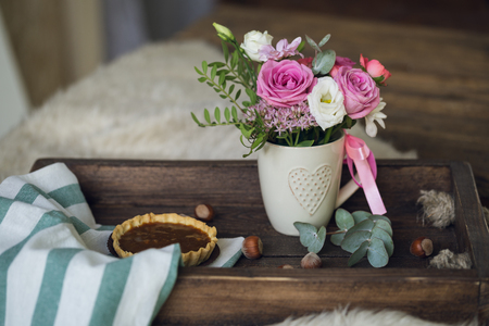 Beautiful flowers in cup on wooden background Stock Photo