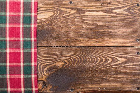 Rustic wooden boards with a red checkered tablecloth