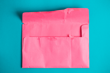 Outdoor pink envelope on a colored blue background. Top view. Stok Fotoğraf