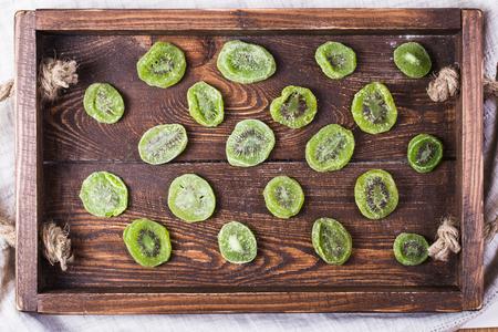 Dried kiwi on wooden background Stok Fotoğraf
