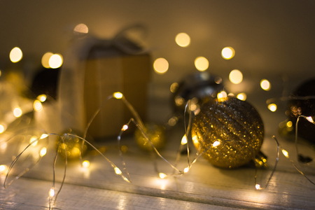 Christmas decoration with fir tree, gift box, garland lights, toys. Winter holidays, Merry Christmas, Happy New Year concept