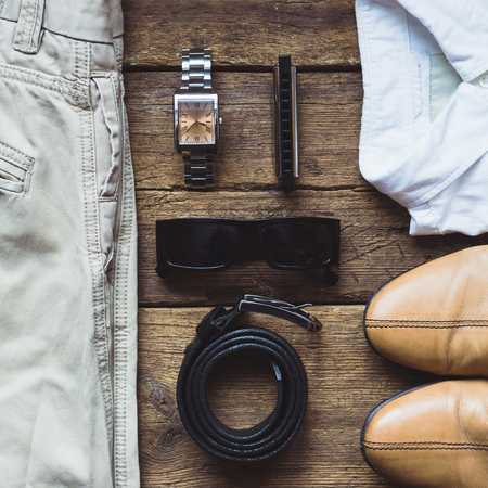 Mens clothes and accessories on wooden background. Top view Stock Photo