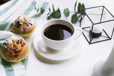 Coffee and two muffins on white background Stockfoto